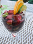 The same fruit used in the Simple Summer Sangria recipe can easily create a bright garnish and presentation.